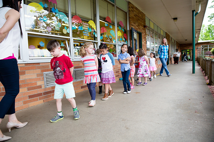 Students practice walking in a line during a preschool program at Marshall Elementary