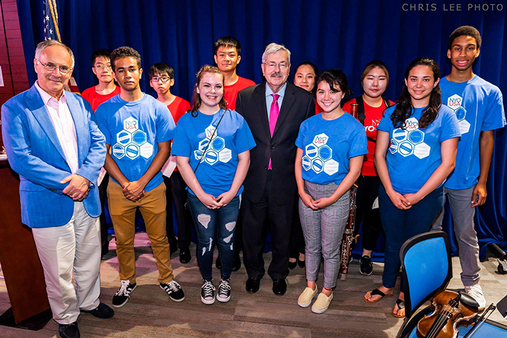 Symphony Koss (front row, second from left) with fellow National Youth Orchestra musicians and U.S. Ambassador to China Terry Branstad (front row, third from left) at the U.S. Embassy in Beijing in July 2018 (photo by Chris Lee, used with photographer permission)