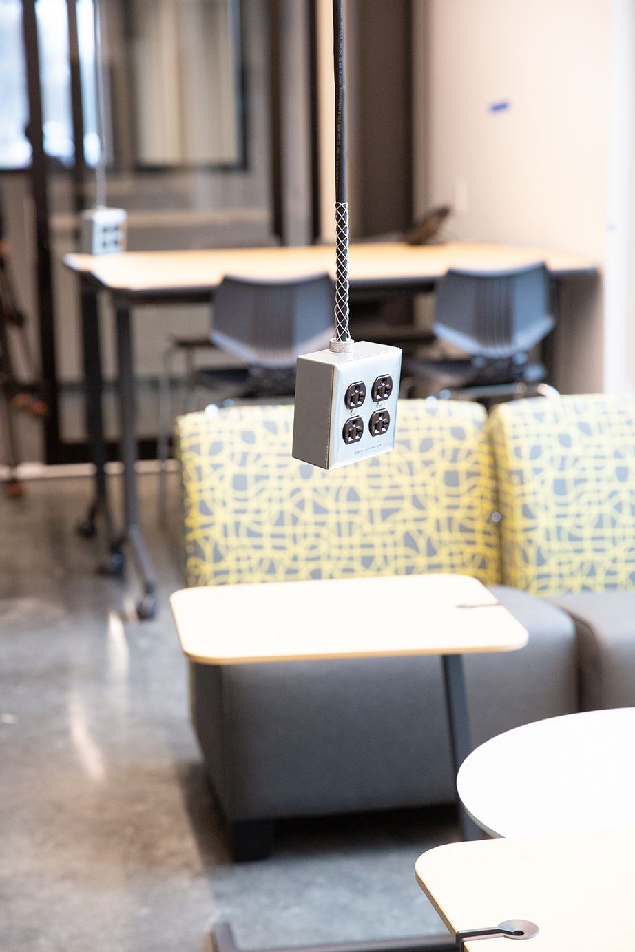 Small group workspace with suspended electrical outlets